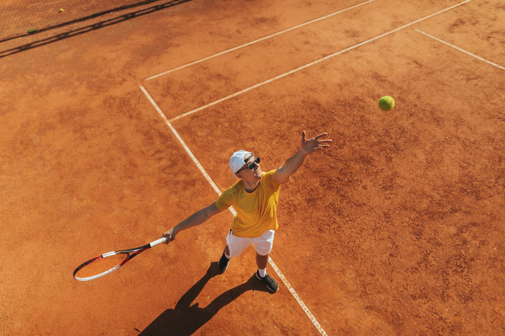 Tennis player on a tennis court during the match